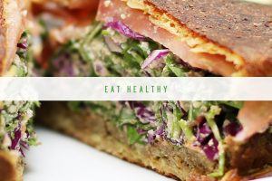 Yummy looking deli sandwich stacked with protein and veggies
